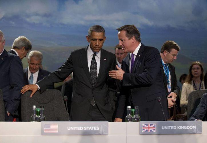 Obama y el premier británico David Cameron enfatizaron la seria amenaza que representa el Estado Islámico, aunque no lograron acuerdos sobre el tema con sus aliados de la OTAN. (AP)