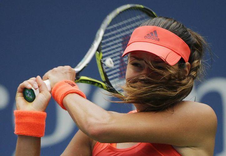 Peor que su propio cabello, lo que se le interpuso a Ana Ivanovic en la primera ronda del US Open fue el tenis de Dominica Cibulkova, quien la eliminó. (Foto: AP)