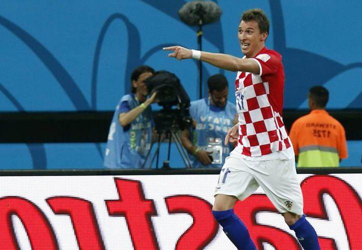 Mandzukic hizo un doblete en su primer partido en este Mundial, en el 4-0 de Croacia sobre Camerún. (EFE)