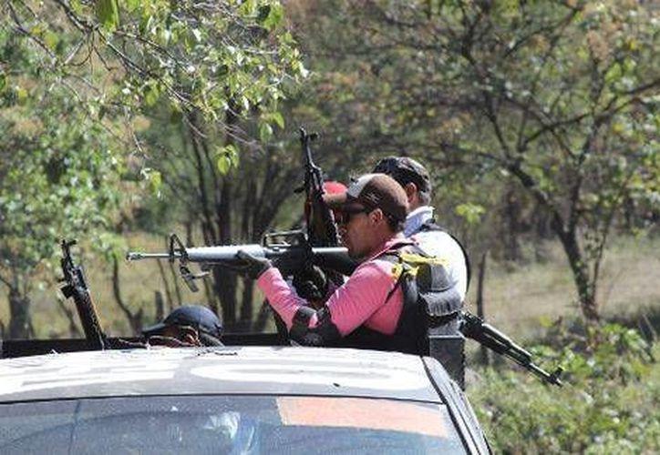 Si nosotros decidimos parar, nos matan, a nuestras familias, porque ellos están armados, declaró Estanislao Beltrán, vocero de las autodefensas de Tepalcatepec. (Milenio/Foto de contexto)