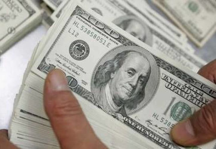 Los centros cambiarios de Cancún y Mérida ofrecieron el billete verde este viernes hasta en 13.35 pesos. (Archivo/Reuters)