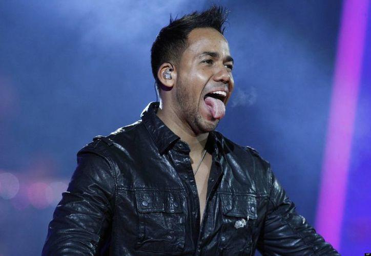 Romeo Santos no descartó un posible reencuentro y realizar una gira musical con sus compañeros del grupo Aventura. (Agencias)