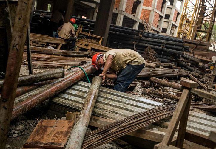 Venezuela tiene la ambiciosa meta de levantar 3 millones de casas para el año 2019. (EFE)