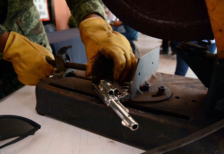 El programa de Registro y Canje de Armas abrirá módulos en los bajos de los palacios municipales de Hunucmá y Progreso. (Archivo-Victoria González/SIPSE)