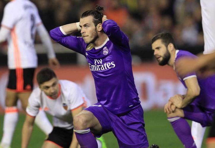 Tras la derrota frente a Valencia, Real Madrid podría perder el liderato en la próxima jornada de la Liga de España.(Alberto Saiz/AP)