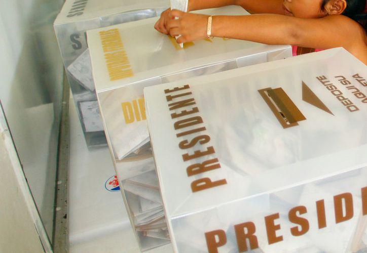 """Los partidos políticos de Yucatán están interesados en """"repatriar"""" 180 mil votos de yucatecos que viven en el extranjero. La imagen es únicamente ilustrativa. (Milenio Novedades)"""