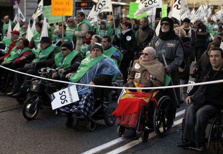 Los protestantes  asistieron muchas de ellas en sillas de ruedas o guiadas por perros lazarillos. (Agencias)