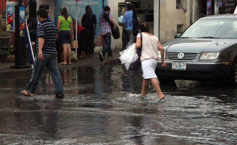 Una fuerte tromba azotó la ciudad de Mérida, este lunes, y dejó inundaciones en varias partes de la ciudad, incluido el Centro de Mérida. La probabilidad de llluvia para hoy es mínima. (José Acosta/Milenio Novedades)