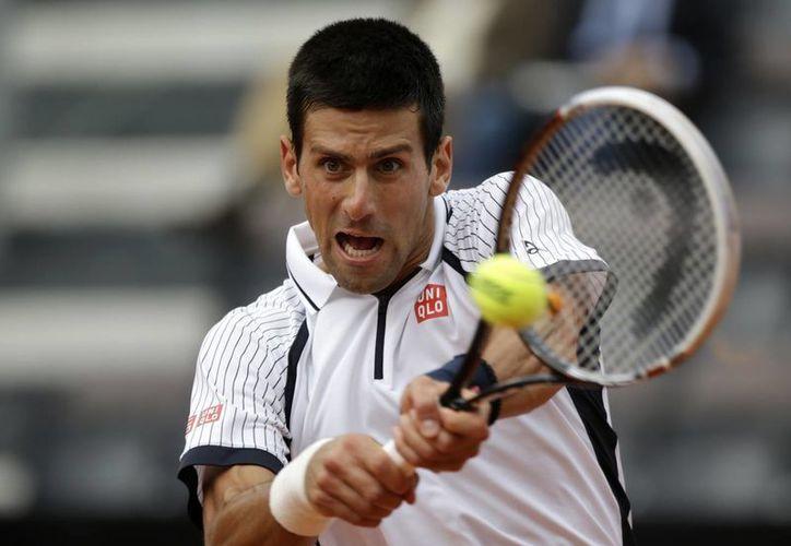 Djokovic se acerca cada vez más al quinto título de master de temporada 2013. (Agencias)