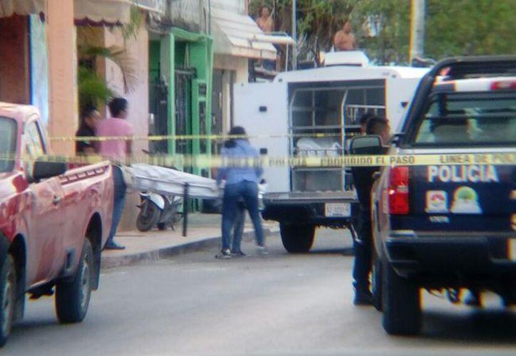 Los cuerpos fueron trasladados al Servicio Médico Forense. (Redacción/SIPSE)