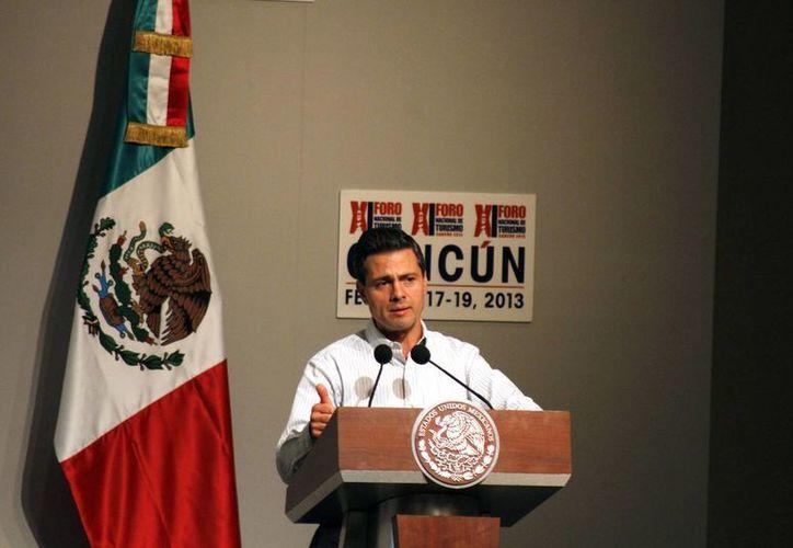 Enrique Peña Nieto en la inauguración del XI Foro Nacional de Turismo. (Israel Leal/SIPSE)