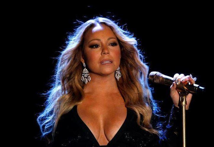 Mariah Carey, quien se tomó un descanso del tramo europeo de su gira mundial 'Sweet Sweet Fantasy Tour', brindó una exclusiva fiesta por su éxito musical. (Archivo AP)