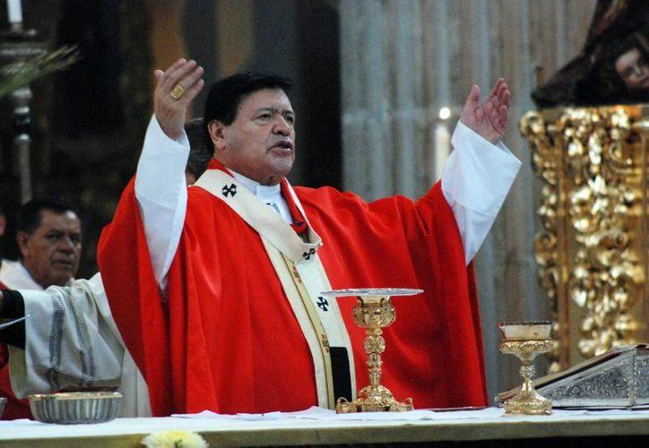"""""""Cuántas heridas, cuánto dolor en el mundo, no faltan las calamidades  y tragedias humanas que provoca innumerables víctimas y daños materiales"""", el cardenal Norberto Rivera Carrera. (Archivo/Notimex)"""