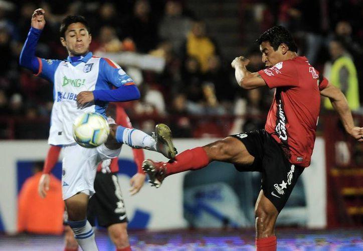 Querétaro, al sorprender a propios y extraños con su triunfo 1-0 sobre Tijuana, dejó de ser parte del grupo de clubes que marchaban sin ganar a domicilio. (Notimex)