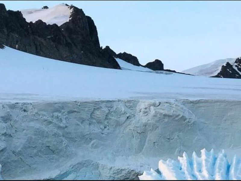 this photo provided by researcher Andrew Shepherd shows an unusual iceberg near the Rothera Research Station on the Antarctic Peninsula.