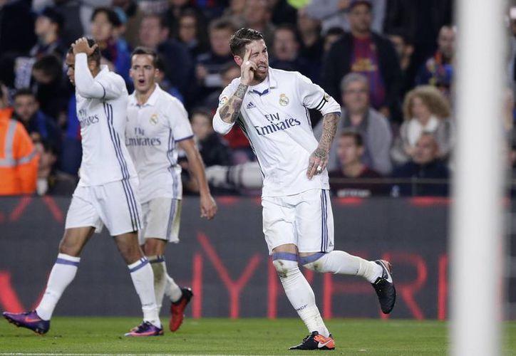 Sergio Ramos se ha convertido en el salvador del Real Madrid tras anotar goles de último minuto en duelos importantes.(Manu Fernández/AP)