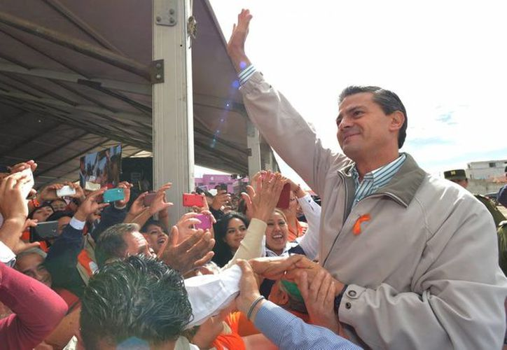 La aprobación del presidente Enrique Peña Nieto cayó en medio de la crisis desatada por la desaparición de 43 estudiantes. (Archivo/Notimex)
