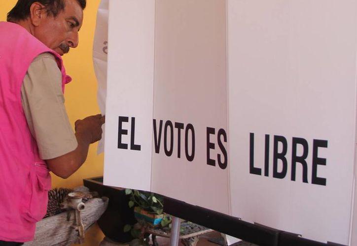 Con el cambio que propone el INE en el mapa electoral de Yucatán, algunos votantes 'cambiarán' de casilla. (Archivo/SIPSE)