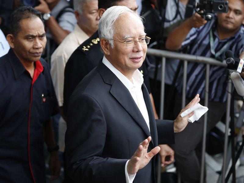 Former Malaysian Prime Minister Najib Razak, center, speaks to media as he leaves the Malaysian AntiCorruption Commission (MACC) Office in Putrajaya in Kuala Lumpur, Malaysia.