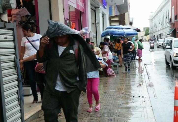 Una onda tropical ingresará mañana al oriente de la Península de Yucatán, generando probabilidad para lluvias fuertes. (José Acosta/Milenio Novedades)