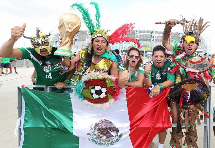 Ocupan el cuarto lugar entre los turistas que más gastan en el Mundial de Brasil 2014. (Notimex)