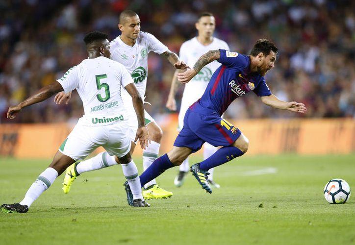Messi metió uno de los goles que llevaron al Barcelona al triunfo. (Foto: AP)