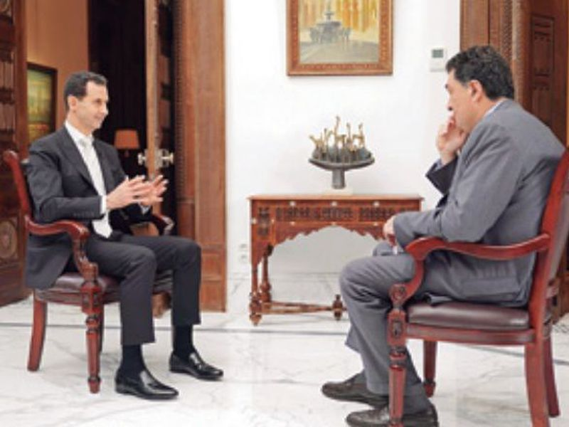 Syrian President Bashar Al-Assad speaks during an interview with Alexis Papachelas, the the executive editor of the Greek Kathimerini newspaper, in Damascus, Syria. (AP)