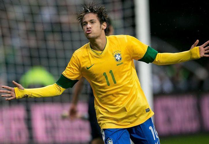 Neymar será distinguido por segundo año consecutivo como el mejor futbolista de América. (Foto: EFE)
