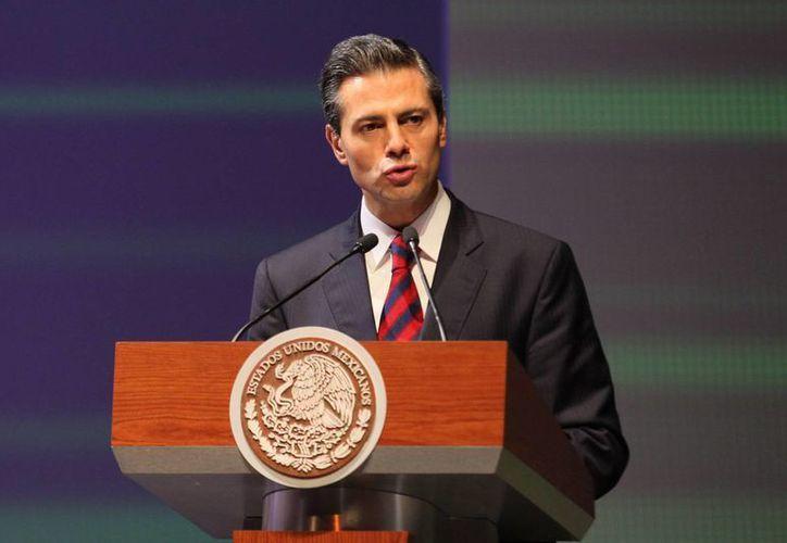 Peña Nieto dijo que su gobierno seguirá trabajando 'para liberar a la Nación de la criminalidad, la corrupción y la impunidad'. (Archivo/Notimex)