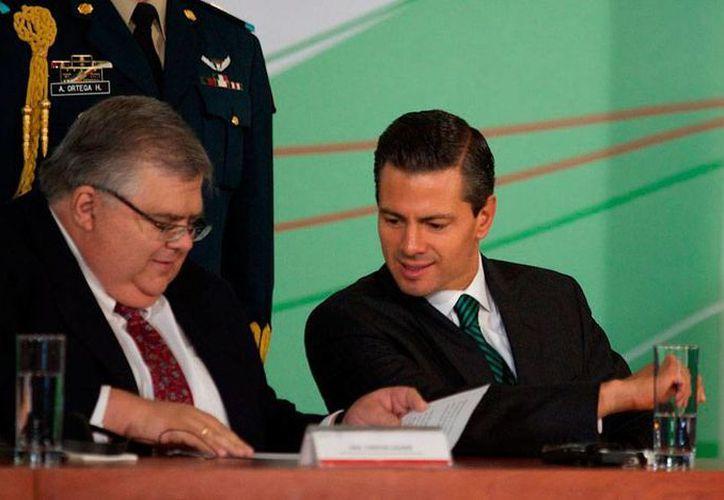 El presidente, Enrique Peña Nieto, destacó el avance logrado gracias a la reformas, por lo que urgió a hacer lo mismo con la del sistema financiero. (AP)