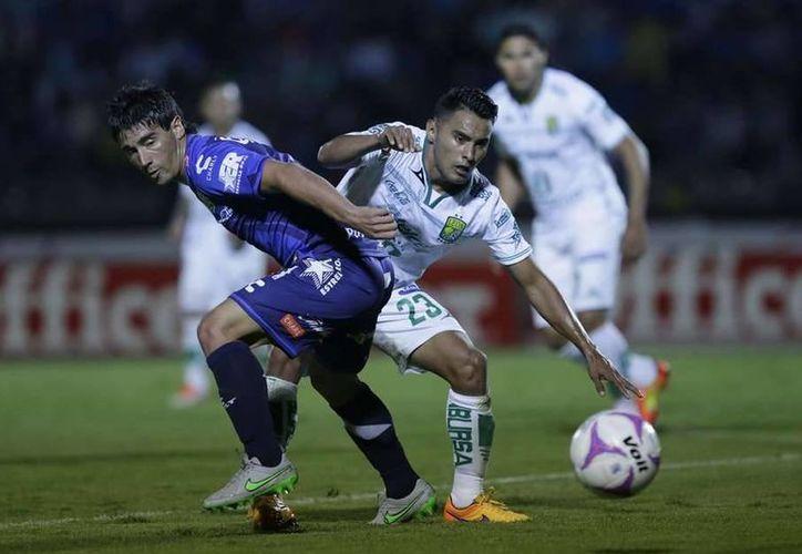 En partido jugado en medio de una casi tormenta, Puebla y León empataron a dos goles. (Imagen de Imago 7)