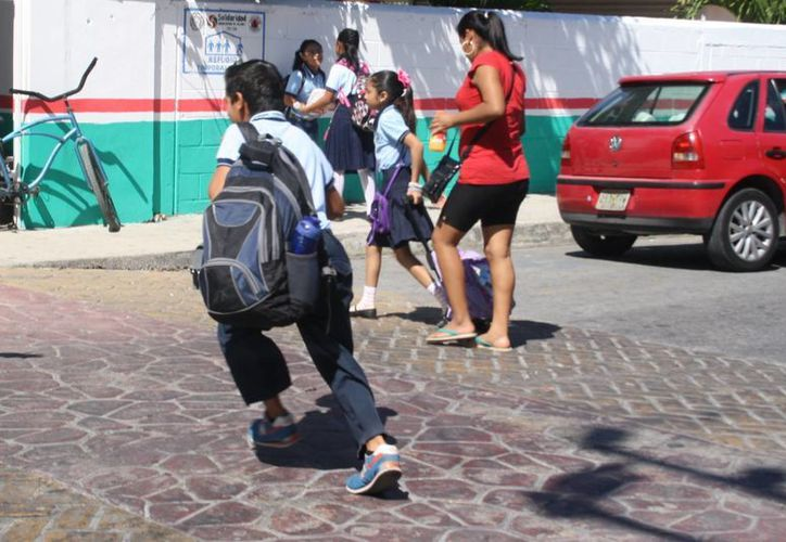 Durante el regreso a clases se pretende limitar las actividades al aire libre en escuelas que no tengan domo deportivo. (Octavio Martínez/SIPSE)