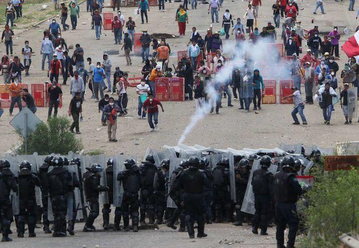 La gravedad de los abusos a los derechos humanos que se cometen en México, pone en riesgo su permanencia en la lista de los países seguros de Canadá. (Agencias)