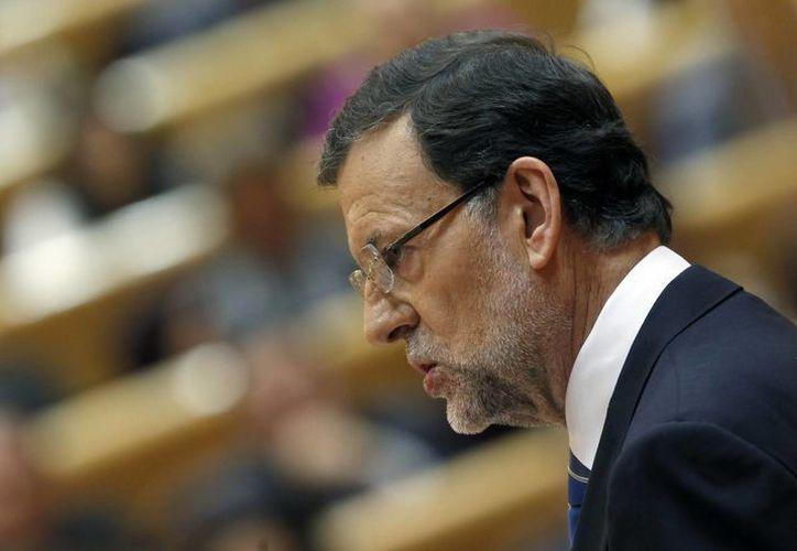 Rajoy durante su comparecencia ante el pleno del Congreso para ofrecer su versión del caso Bárcenas, esta mañana en el Senado. (EFE)