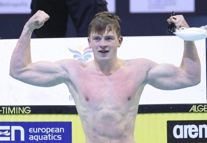 Adam Peaty puso nombre con letras de oro en la historia de la natación mundial al romper un récord en 50 metros estilo pecho. (EFE)