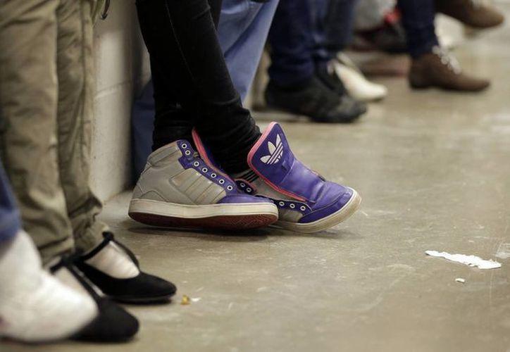 Los inmigrantes centroamericanos seguirán esperando hasta que se decida su suerte. (AP)
