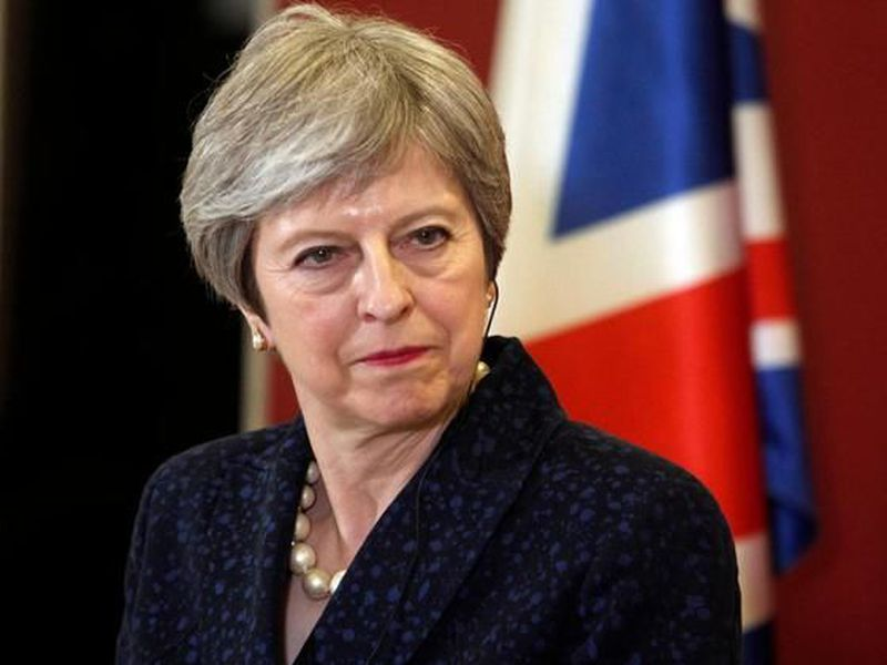 British Prime Minister Theresa May looks on during a news conference.