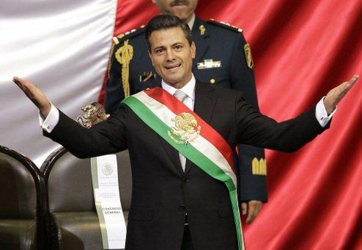 Peña Nieto se inició en el PRI a los 18 años de edad. (Agencias)