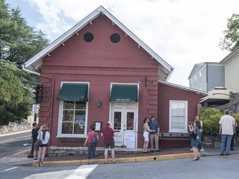 Passersby gather to take photos in front of the Red Hen Restaurant, Saturday, June 23, 2018, in Lexington, Va.