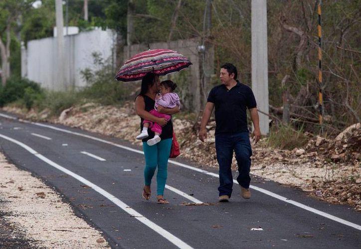 A pesar de que el pronóstico es de lluvia fuerte para Yucatán, el calor se mantendrá como un 'ingrediente' del clima, con 32 grados como máxima. (Mauricio Palos/SIPSE)
