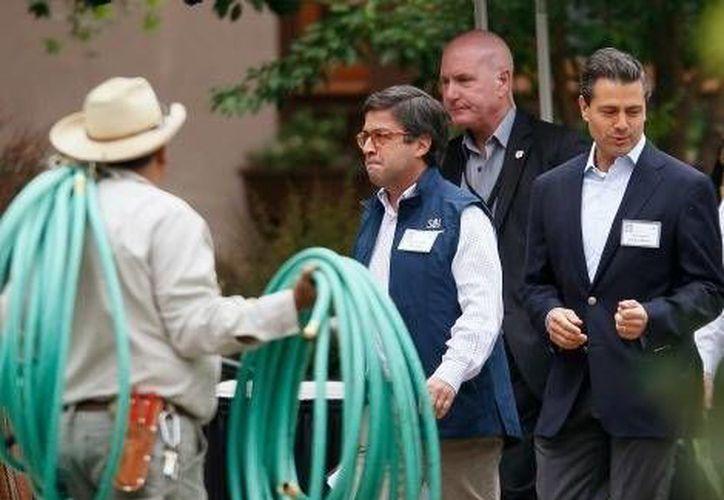 Enrique Peña Nieto a su llegada a la conferencia. (Imagen tomada de MILENIO/Reuters)