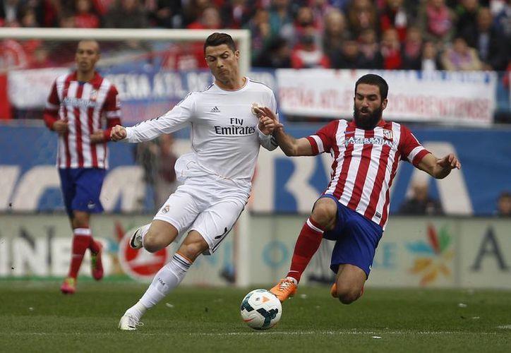 En el minuto 82 Cristiano Ronaldo metió el gol que permitió al Real Madrid lograr la igualada con el Atlético de Madrid. (Agencias)