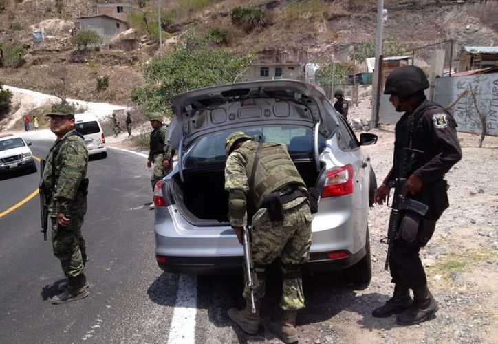 Desde hace unas semanas, elementos de la policía federal y del Ejército han reforzado la seguridad del municipio. (Archivo Notimex)