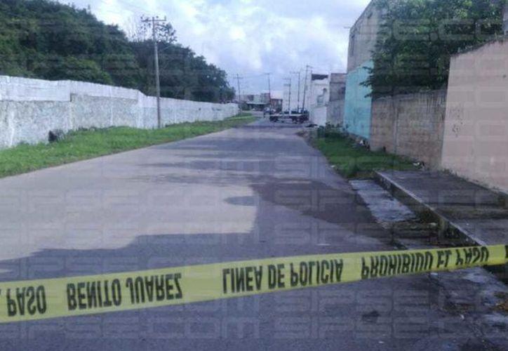 Una persona perdió la vida en la supermanzana 99, presuntamente por disparos de arma de fuego. (Orville Peralta/SIPSE)
