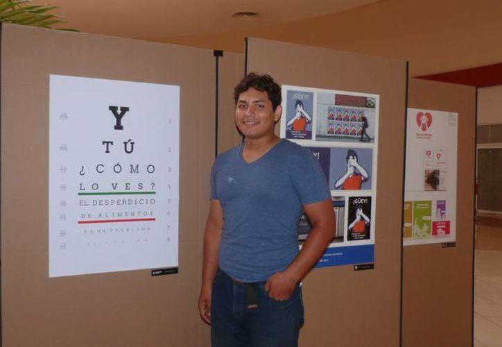 Alberto Enríquez Lara, estudiante de diseño de la Universidad Riviera, participará en la Bienal Internacional del Cartel en México.  (Luis Ballesteros/SIPSE)