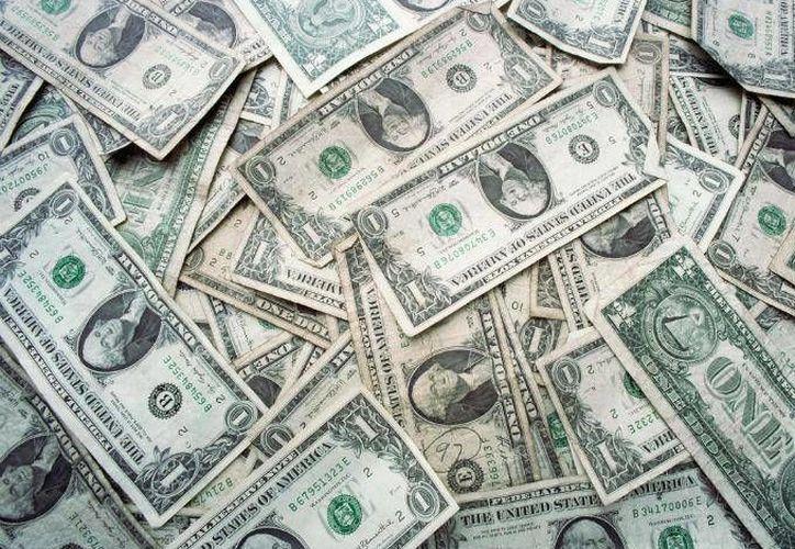 De manera acumulada, las reservas internacionales se han elevado en 13 mil 696 millones de dólares.  (dineroenimagen.com)
