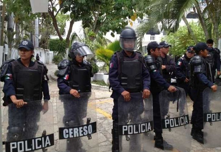 La caravana policiaca está conformada no solo por agentes y camiones, sino por un helicóptero. (Notimex/Foto de archivo)