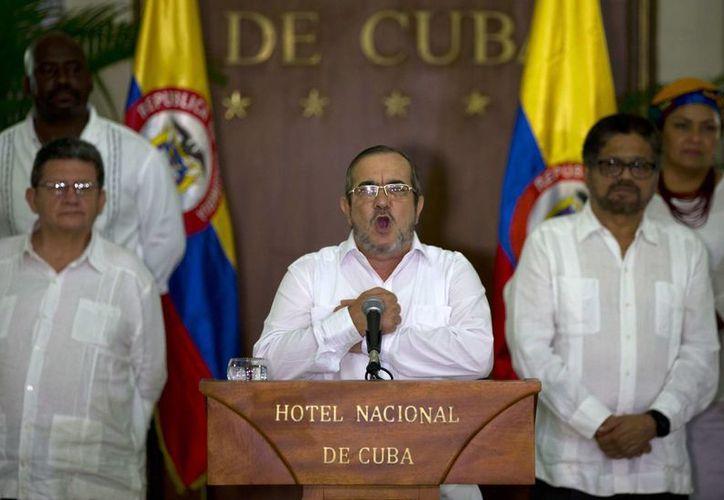 Las FARC anunciaron el domingo 28 de agosto de 2016 que a partir del primer minuto del lunes cesaban definitivamente sus hostilidades dentro del proceso de paz que está en la recta final para poner fin a un conflicto armado interno que ha durado cinco décadas. (AP foto/Ramón Espinosa)