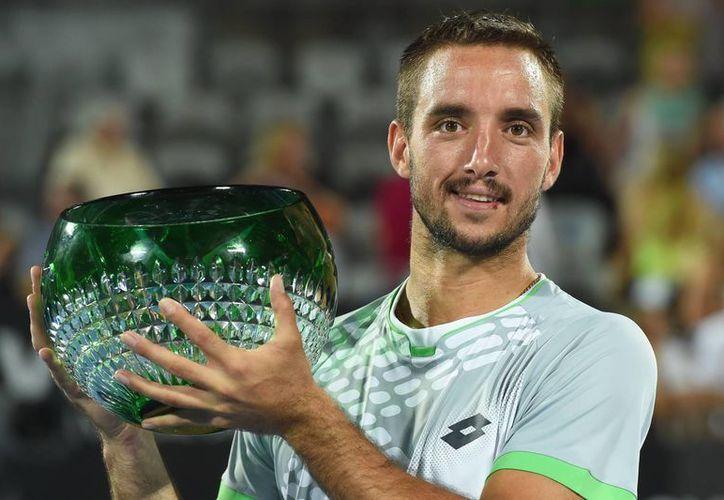 El tenista númeo 92 del mundo, Viktor Troicki, se hizo con el trofeo del torneo de Sidney. (EFE)