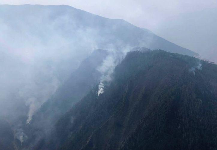 Un cambio de dirección en el viento provocó la muerte de varios bomberos. (Xinhua)